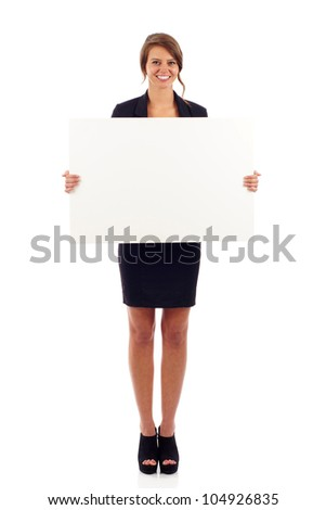 Full length portrait of a cute young woman holding a blank board isolated over white background