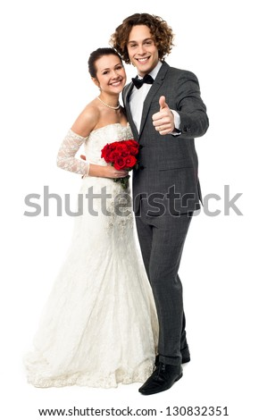Full length portrait of a dashing young bridegroom gesturing success. - stock photo
