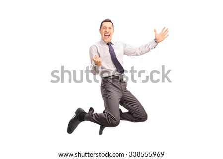 Full length portrait of a delighted businessman jumping and gesturing success shot in mid-air isolated on white background - stock photo
