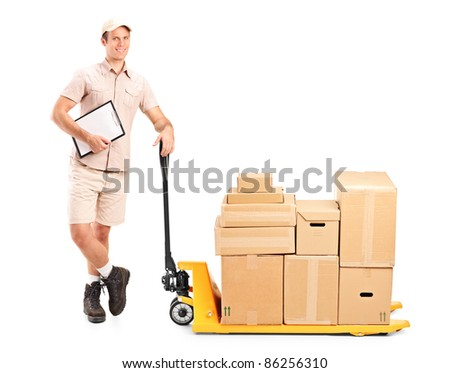 Full length portrait of a delivery person holding a clipboard and a fork pallet truck stacker isolated on white background - stock photo