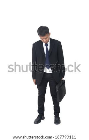 Full length portrait of a disappointed businessman walking with a briefcase isolated on white background  - stock photo