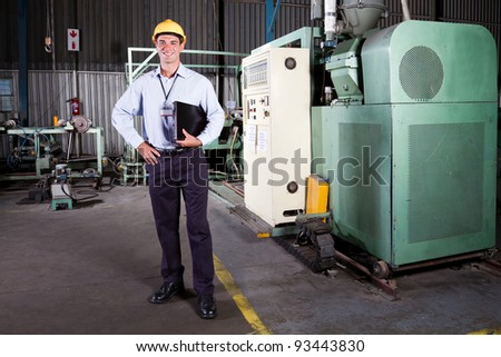 full length portrait of a factory manager - stock photo
