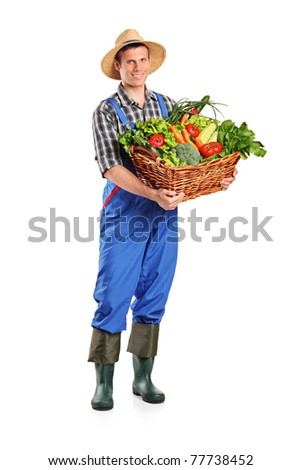 Full length portrait of a farmer holding a basket of vegetables isolated on white background