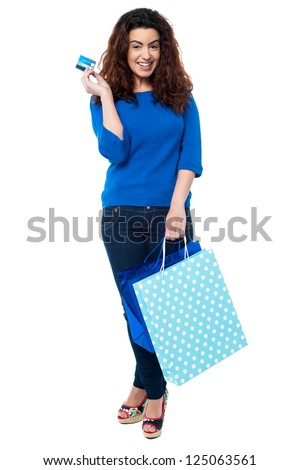 Full length portrait of a fashionable woman posing with shopping bags and credit card. - stock photo