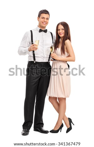 Full length portrait of a fashionable young couple holding glasses of white wine isolated on white background