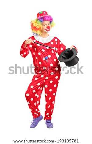 Full length portrait of a female clown holding a magician hat isolated on white background - stock photo