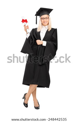 Full length portrait of a female college graduate holding a diploma and leaning against a wall isolated on white background