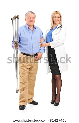 Full length portrait of a female doctor or nurse holding a senior patient with crutches isolated on white background - stock photo
