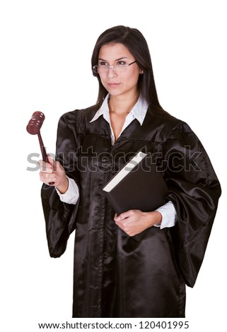 Full length portrait of a female judge in a gown carrying a law book and a wooden gavel as she prepares to go to court isolated on white - stock photo