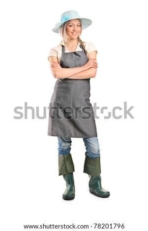 Full length portrait of a female manual worker posing isolated on white background - stock photo