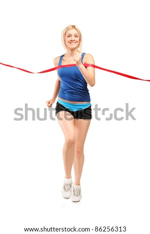 Full length portrait of a female runner running towards a finish line isolated on white