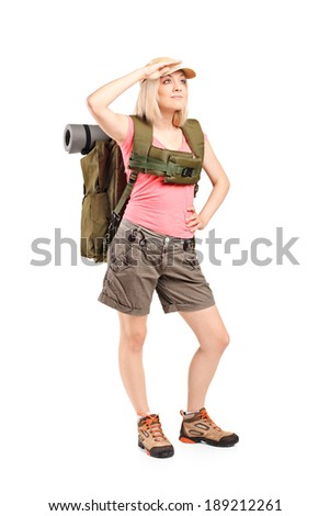 Full length portrait of a female scout with backpack isolated on white background