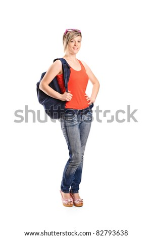 Full length portrait of a female student with school bag isolated on white background - stock photo