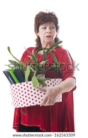 full length portrait of a fired woman carrying a box of personal items isolated on white background - stock photo