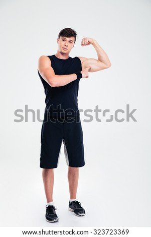 Full length portrait of a fitness man showing his biceps isolated on a white background - stock photo