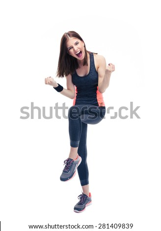 Full length portrait of a fitness woman celebrating her victory isolated on a white background - stock photo