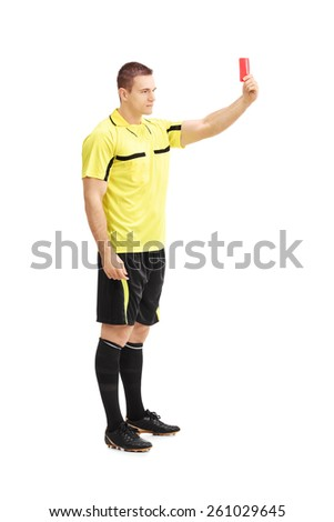 Full length portrait of a football referee showing a red card isolated on white background - stock photo