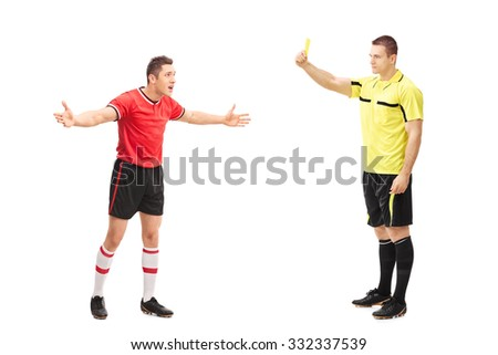Full length portrait of a football referee showing a yellow card to a displeased player isolated on white background - stock photo
