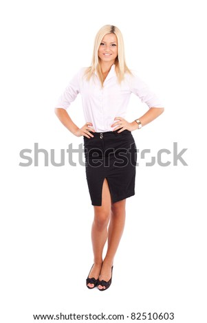 Full length portrait of a friendly businesswoman isolated on white background