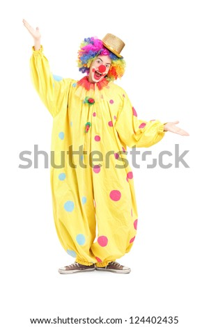 Full length portrait of  a funny circus clown gesturing with hands isolated on white background