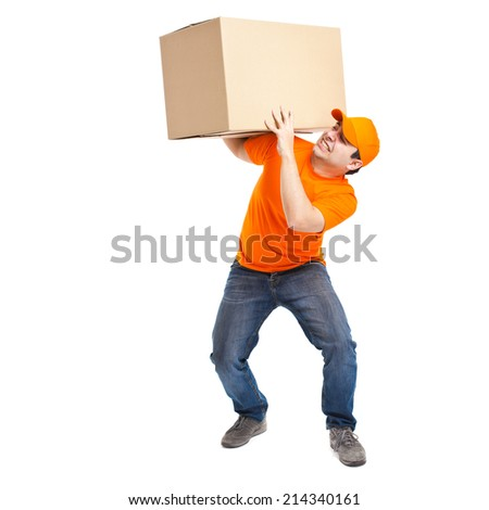 Full length portrait of a funny deliverer lifting an heavy box. Isolated on white - stock photo