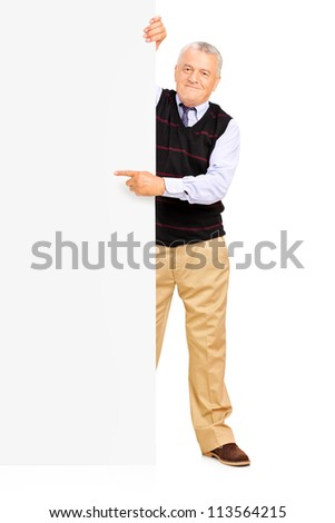 Full length portrait of a gentelman pointing on a blank banner - stock photo