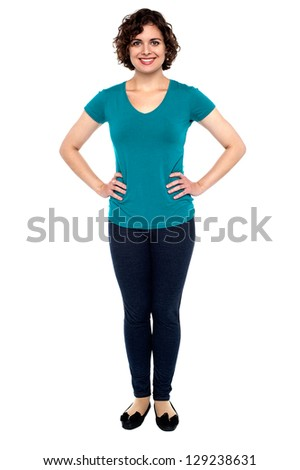 Full length portrait of a gorgeous young woman standing with hands on waist. - stock photo