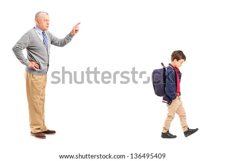Full length portrait of a grandfather reprimanding a little boy, isolated on white background - stock photo