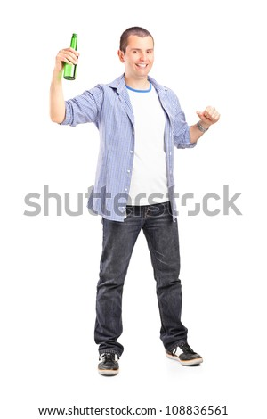 Full length portrait of a guy holding a beer bottle isolated on white background - stock photo