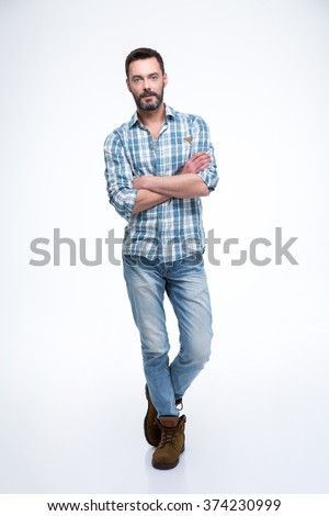 Full length portrait of a handsome man standing with arms folded isolated on a white background - stock photo