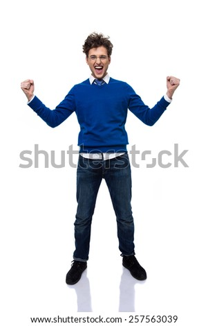 Full length portrait of a happiness man with hands raised up - stock photo