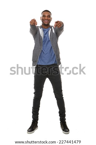 Full length portrait of a happy african american man pointing finger  - stock photo