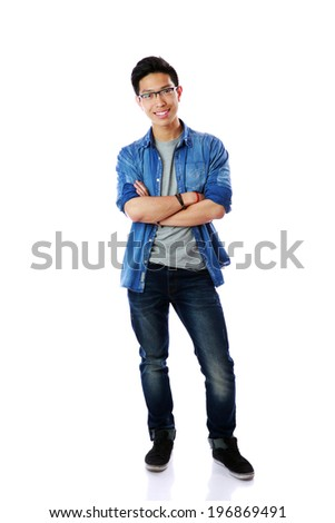 Full-length portrait of a happy asian man with arms folded over white background - stock photo