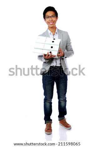 Full length portrait of a happy asian man with folders over white background - stock photo
