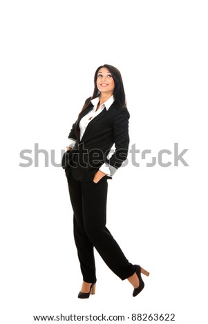 Full length portrait of a happy business woman standing posing in modern suit isolated over white background
