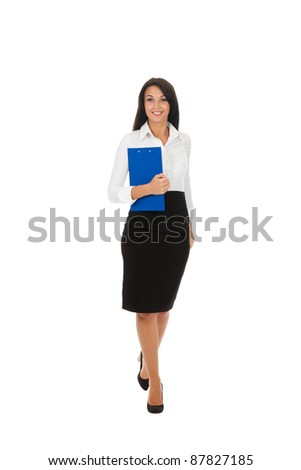 Full length portrait of a happy business woman with folder isolated over white background - stock photo