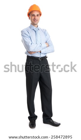 Full length portrait of a happy businessman in helmet over white background - stock photo