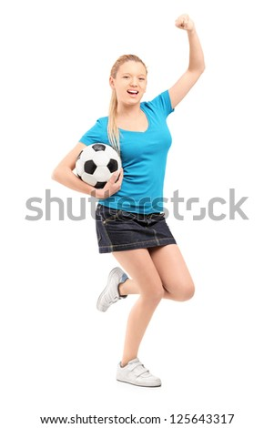 Full length portrait of a happy female holding football and cheering isolated on white background