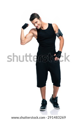 Full length portrait of a happy fitness man showing his biceps isolated on a white background - stock photo