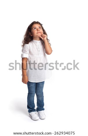 Full length portrait of a happy little girl looking up on white background - stock photo