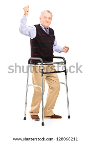 Full length portrait of a happy mature gentleman with walker gesturing happiness isolated on white background