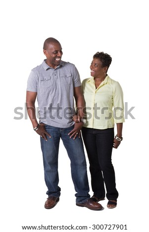 Full length portrait of a happy older couple isolated on white. - stock photo