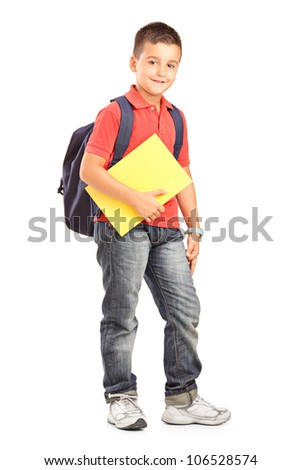 Full length portrait of a happy school boy with backpack holding a notebook isolated on white background
