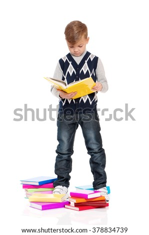 Full length portrait of a happy schoolboy with books isolated on white background - stock photo