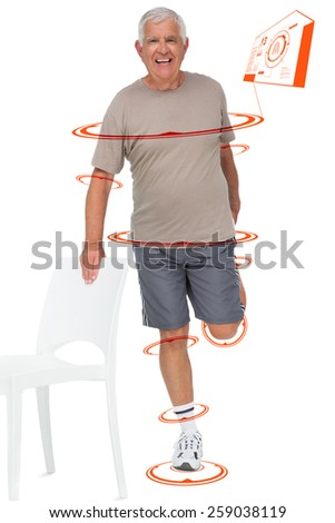Full length portrait of a happy senior man stretching leg against fitness interface - stock photo