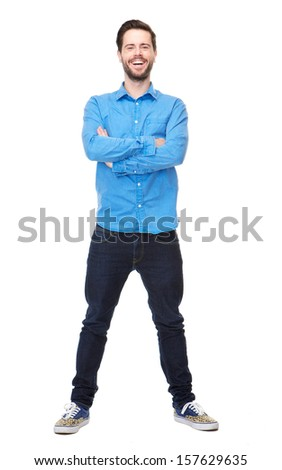 Full length portrait of a happy young man standing on isolated white background - stock photo
