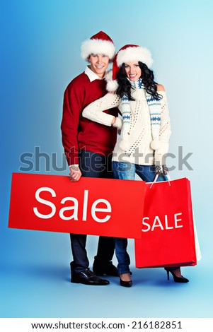 Full length portrait of a happy young people standing with a lot of shopping bags. Sale.  - stock photo