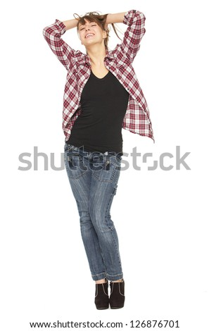 Full length portrait of a happy young woman - stock photo