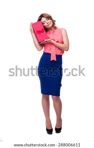 Full length portrait of a happy young woman holding gift isolated on a white background - stock photo