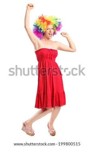 Full length portrait of a happy young woman with a wig gesturing joy isolated on white background - stock photo